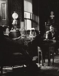 Holmes and Watson in 221B Baker Street.