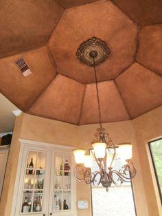 Metallic copper dome with wall glaze.