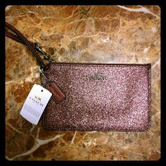 Coach pink glittery wristlet! Adorable & NWT! Super cute pink glittery/sparkly Coach flat wristlet. Brand new with tags and never used. Retail price $89.99 Coach Bags Clutches & Wristlets