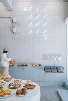 fathom designs japanese bakery ripi as a continuous space of concrete + glass Bakery Shop Design, Coffee Shop Design, Restaurant Design, Store Design, Kiosk Design, Restaurant Interiors, Design Shop, Bakery Interior, Cafe Interior Design