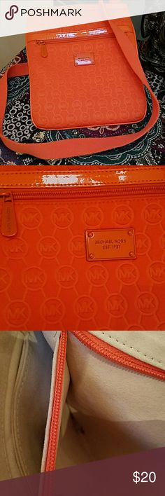 Michael Kors must have crossbody Hands free living!  Adorable orange MK crossbody with deep pockets and adjustable cotton strap.  Small ink stain in one of the interior pockets.  There are a few spots that show a little wear - see pic.  Love using these when I go shopping. Michael Kors Bags Crossbody Bags