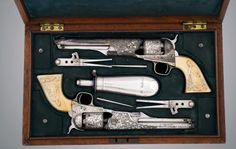 Boxed set of fancy Colt 1861 revolvers