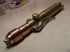 """Steampunk Lightsaber""  I've had this idea walking thru the shops at work. Part of that handle is a cutting torch."