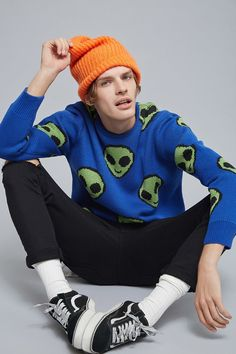 A heavyweight knit sweater with an allover alien emoji graphic print, a round neckline, dropped shoulders, long sleeves, and ribbed trim.