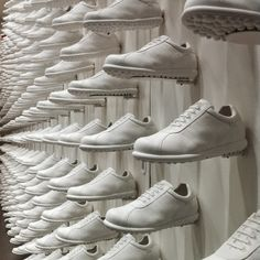 "CAMPER,""close-up white shoe wall"", pinned by Ton van der Veer"