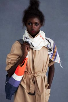 Ethiopian scarf + trench coat + tote bag.... I've got that down. No need to blow the bank on Lemlem.