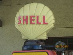 Detail of Shell petrol pump from an old garage forecourt in Colyton, Devon.