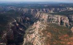 President Trump has announced plans to slash the size of two US national parks, provoking fury from environmentalists, native american tribes and conservationists.
