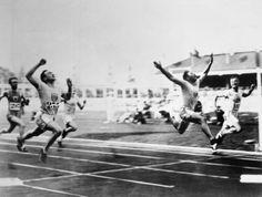 vintage olympics - Sprinter Charlie Paddock Winning Olympic 100-Meter Dash