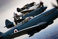 etonnement:  fabforgottennobility:this shot makes my day Spitfire and Hurricane aircraft from World War II come together over Lincolnshire, for the Lincolnshire Lancaster Association Day event held at RAF Coningsby. This image was a runner-up in the 2010 RAF Photographic Competition for SAC Sally Raimondo.  swatches
