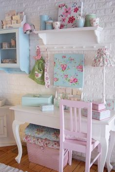 What little girl wouldn't like her own desk area decorated with aqua, pinks and blues set against white, the ever perfect background for unashamed prettiness . . .