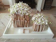 Schelpen met zijden bloemen