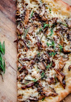 Mushroom Pizza with Havarti Cheese, Fresh Herbs, and White Truffle Oil. A decadent and hearty vegetarian pizza recipe for fall and winter.