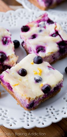 Creamy lemon cheesecake bars studded and swirled with blueberries. They're prepared on my simple graham cracker crust and will absolutely be your new favorite dessert!
