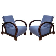 A pair of chic Art Deco armchairs .Dark palissandre with brass bar detail. Newly upholstered in a blue wool and cashmere upholstery.