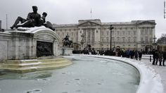 A frozen fountain stands in front of Buckingham Palace in London on Sunday. Heavy snow fell overnight across southeast England, causing many roads to become blocke