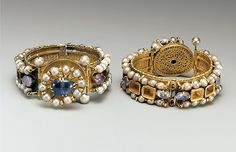 Jeweled Bracelet Date: 6th–7th century Geography: Made in probably Constantinople Culture: Byzantine Medium: Gold, silver, pearl, amethyst, sapphire, glass, quartz, emerald plasma Dimensions: Overall: 1 7/16 x 3 1/4 in. (3.7 x 8.2 cm) strap: 15/16 x 7 7/8 in. (2.4 x 20 cm) bezel: 1 5/16 in. (3.4 cm) Classification: Metalwork-Gold Credit Line: Gift of J. Pierpont Morgan, 1917 Accession Number: 17.190.1670