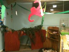 We made a cave in the classroom and some of the children brought in some real branches!