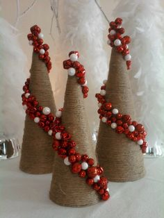 Christmas Bell Cone Trees - like the idea of wrapping a cone with a fun garland.