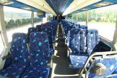 These prevost buses are actually a lot of fun to ride in. I mean, just look at that great blue interior! I remember we had a big get-together once, and used one of these rental buses, and everyone loved it.
