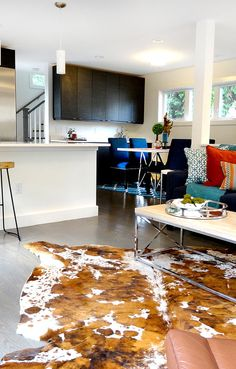 Cowhide Rug, modern eclectic interior with bright colors