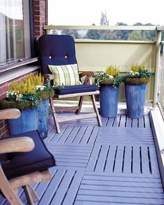 A cool looking and definitely eye catching apartment balcony décor. The wonderful blue colors blend in so well and works well with the wooden furniture. The potted plants also look great with DIY bins as personalized pots.
