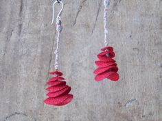 Red earring made from silk cocoon by Mieke Recour, Belgium