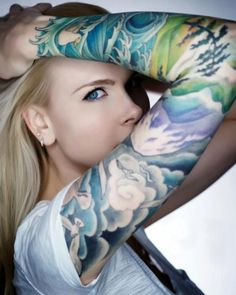 Japanese-inspired designs are very popular images for full sleeve tattoos for girls. This girl has a black and white arm tat depicting a nature scene, and the full sleeve tattoo begins at her wrist Colorful Sleeve Tattoos, Full Sleeve Tattoos, Tattoo Sleeve Designs, Tattoo Designs For Women, Tattoos For Women, Tattoo Sleeves, Tattooed Women, Ocean Sleeve Tattoos, Ocean Tattoos