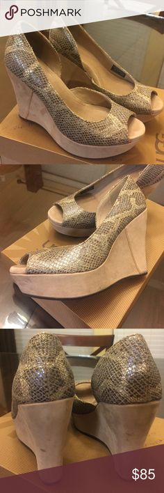 UGG Australia Wedges Women's Toura Sand color and Metallic snakeskin. Rubber sole. Really comfortable. Worn a few times. There are tiny scuff marks in the back of the wedge as you can see in pictures. Otherwise in great condition. Any questions please ask before purchasing. Thank you! UGG Shoes Wedges