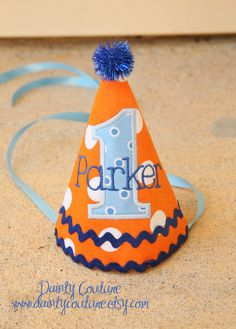 Boys First Birthday Party Hat - Fun orange and blue dots theme - Free personalization. $25.00, via Etsy.