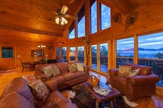 All Inspired Lodge | Cabin Rentals of Georgia - The Great Room featuring Stunning Window Wall Overlooking the Mountains in the Distance
