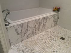 Tub front in Calcutta Marble.