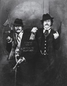 Pablo Escobar (right) poses as a gangster in Las Vegas, next to his cousin Gustavo Gaviria in the 1980s.