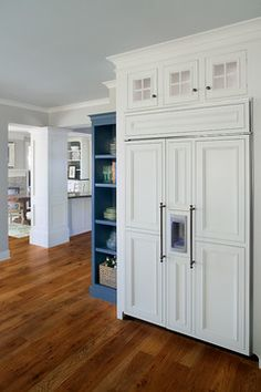 This is Sub-Zero refridgerator/freezer (one appliance). The water/ice maker is part of the refrigerator door, we just laid out the paneling and door handles a little differently so the larger refrigerator door would still appear to be spaced like the rest of the cabinetry in the kitchen. A nifty little design trick that makes a large refrigerator easier on the eye!