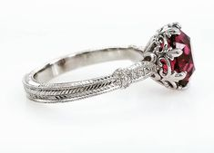 "Check out this gorgeousness! 😍 My #loveaffairdiamonds ""Olivia"" solitaire, in platinum, set with my client's beautiful 9mm garnet to honor and remember her mom. I think it's just a stunning combination - the colored center stone really makes all that gorgeous and intricate metalwork pop, especially those fleur de lis prongs! This setting is available to custom order for any center stone! . . . #solitaire #ring #beplatinum #platinum #garnet #modernbride #bridal #theknotrings #martharings…"