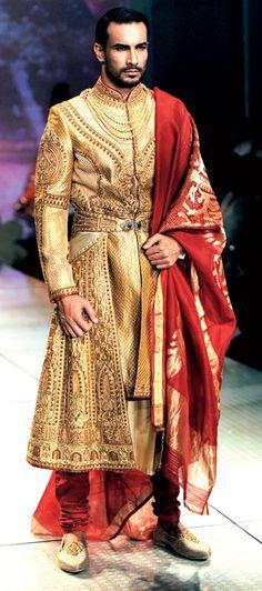 Tarun Tahiliani showcased a gold sherwani with gold threadwork, which ...