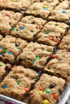 {One-Bowl, Big-Batch} Monster Cookie Bars ~ loaded with chewy oats, decadent peanut butter, colorful M&Ms, chocolate chips, and peanut butter chips, this effortless recipe whips up in no time! It is then spread in a large rimmed sheet pan to yield a big batch of bar cookies, perfect for sharing or serving at parties. Even better, you can customize these yummy bar cookies for various holidays by using seasonal M&Ms! | FiveHeartHome.com