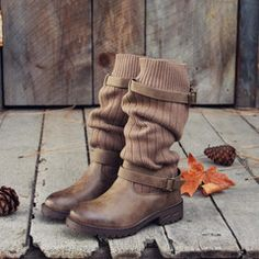 Chilly nor'wester winds won't bother you in these darling cozy boots. A black base pairs with a flap-over top design and sweet boot sock detail. Lace-up front with a rugged treaded sole. A soft plaid