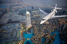 A Dassault Falcon 7X flies near the Burj Khalifa, Dubai