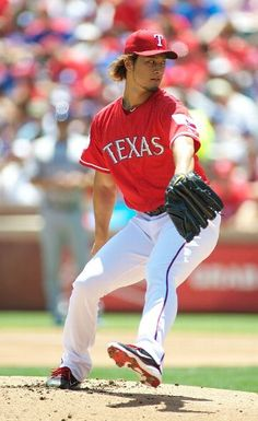 ARLINGTON, TX - MAY 27:  Yu Darvish #11 of the Texas Rangers pitches against the Toronto Blue Jays at Rangers Ballpark in Arlington on May 27, 2012 in Arlington, Texas.  (Photo by Cooper Neill/Getty Images)  game 48