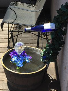 How to make your own wine bottle fountain. – Fountains R Us Wine Bottle Fountain, Diy Water Fountain, Garden Water Fountains, Outdoor Fountains, Fountain House, Fountain Lights, Fountain Ideas, Indoor Fountain, Homemade Water Fountains