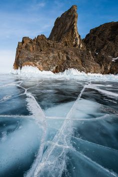 Streaks and cracks on the crystal clear ice on the frozen Lake Baikal, Siberia, Russia.
