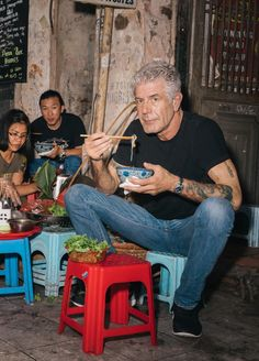 """Bourdain, in Hanoi. He says, """"I travel around the world, eat a lot of shit, and basically do whatever the fuck I want."""""""