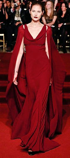 Zac Posen....A beautifully flowing evening gown. I would wear it with ought the cape though.