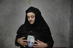 A photojournalist captures the mourning rituals for 21 Egyptian Coptic Christians beheaded by ISIS in Libya.