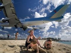 oh how fun!  Landing at Princess Juliana International Airport, a looming 747 thrills visitors on Mahó beach, a famous plane-watching spot.  Photograph by Kent Miller