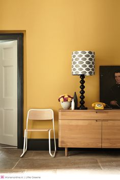 Little Greene Paint - Yellow walls with Black coloured skirting boards Mustard Yellow Paints, Mustard Yellow Walls, Coloured Skirting Boards, Yellow Hallway, Little Greene Paint, Yellow Interior, Color Interior, Interior Paint, Black Lamps