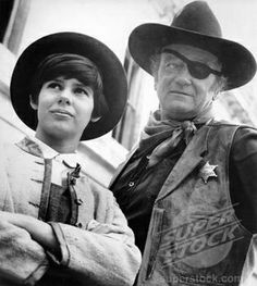 """TRUE GRIT (1969) - """"Mattie Ross"""" (portrayed by Kim Darby) & """"Rooster Cogburn"""" (portrayed by John Wayne) team-up to search for the outlaw that killed her father - Produced by Hal Wallis - Directed by Henry Hathaway - Paramount Pictures - Movie Still."""