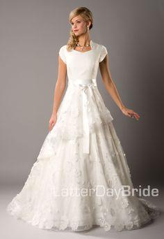 A little more contemporary yet still simpler modest wedding dress