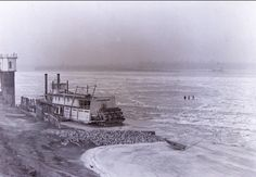 Steamboat Parker.  The boat is stuck on the Mississippi river because the river has frozen over.  If you look closely, you can see three people walking across the river.  Vintage by Lins